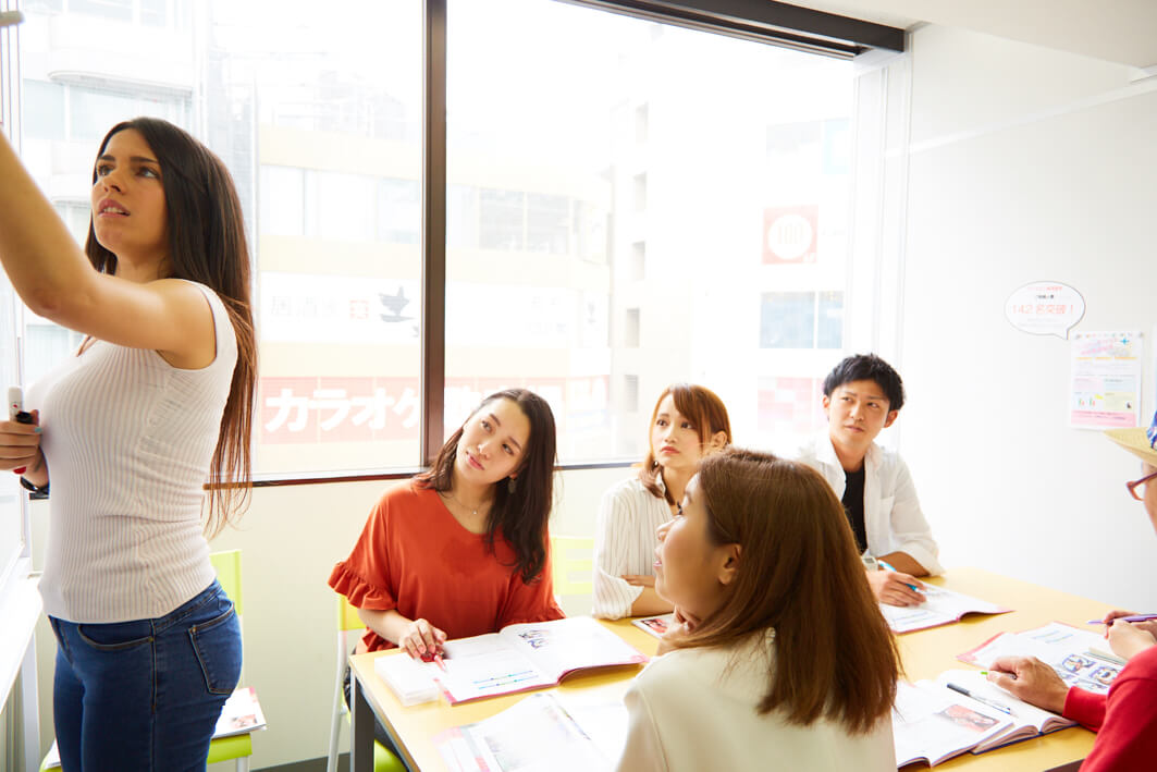Girl teaching a class of Japanese people