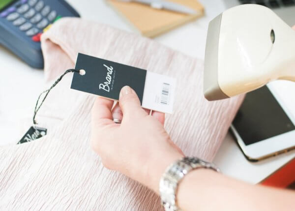 Person scanning a barcode in retail